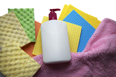 Assortment of various bright means for tidy. Container with liquid for glass cleaning, wipes, multi color wisp, bast, dishrag and dishcloth for house dust wash. Detail closeup view with space for text Stock Photo