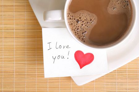 a love note with a cup of coffee on the table  photo