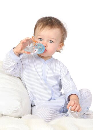 baby is drinking water from bottle photo