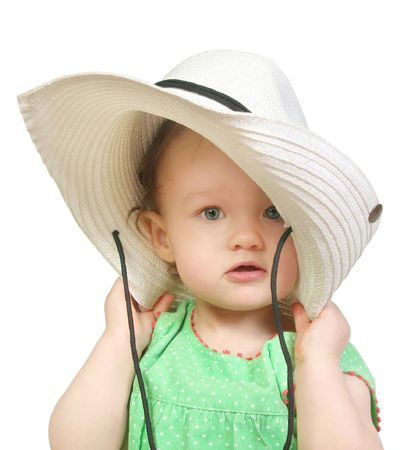 baby girl in a big white hat photo
