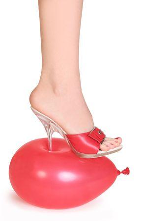 red balloon under spike heel