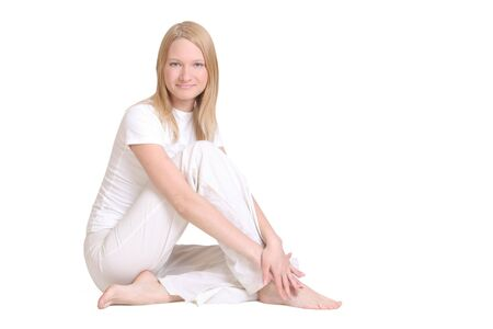 smiling young woman in white clothes Stock Photo