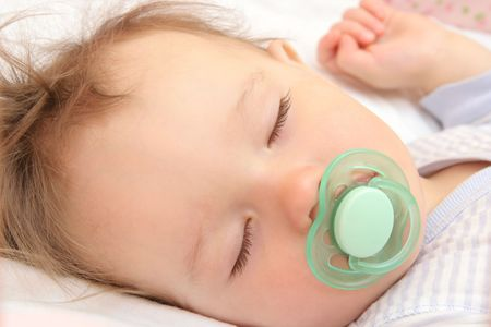 baby with soother: nice sleeping baby