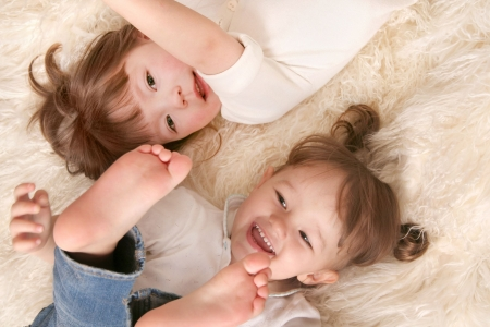 babycare: Two girls laughing Stock Photo