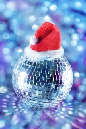 Shiny disco ball in santa hat  Stock Photo