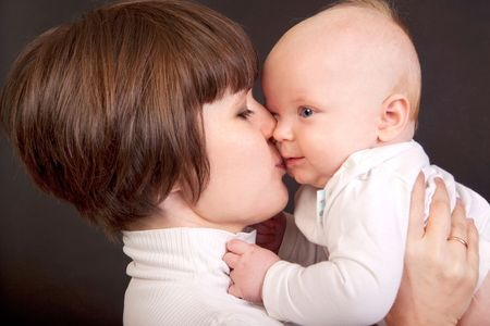 mother kissing her little baby Stock Photo - 8048548