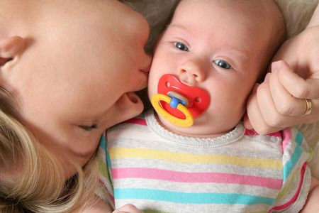 mother kissing her little baby Stock Photo - 8048544