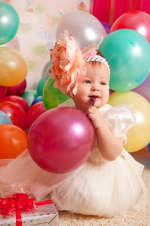 Happy birthday baby, Little girl with group ball. Play room.
