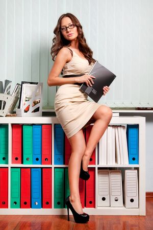 sexy young business lady in office Stock Photo