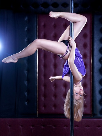 Young sexy pole dance woman photo