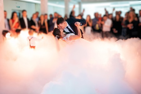 Beautiful bride and handsome groom dancing first dance at the wedding party. Very tender moment Stock Photo