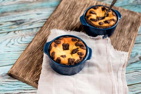 Delicious appetizing mini cheesecakes homemade in ceramic mold Stock Photo