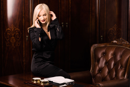 Attractive young woman sits in a beautiful office. Working atmosphere
