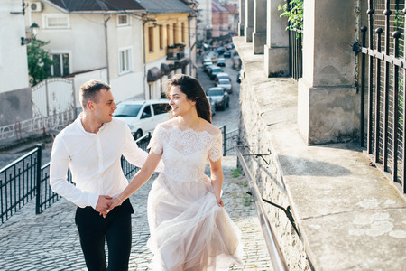 A young, sympathetic couple walks through the streets of the city. Love