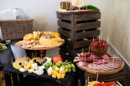 Festive table for brides and their guests. Snack for alcoholic beverages on the buffet table Reklamní fotografie