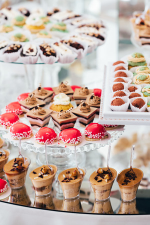 Festive table for newlyweds and guests. Dessert table for a wedding party