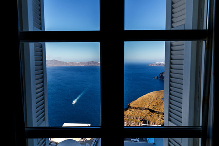 Window with view of sea , Santorini, Greece Reklamní fotografie
