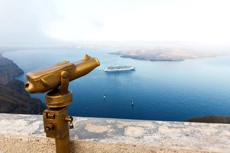Touristic telescope look at the sea from town in Santorini island. Reklamní fotografie