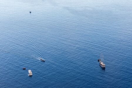 Top view of a white boat sailing in the blue sea Reklamní fotografie