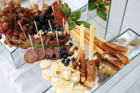 Luxury food and drinks on wedding table.