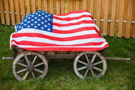 American flag lying on the grass. Independence Day