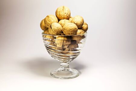 solid walnuts in a glass bowl photo