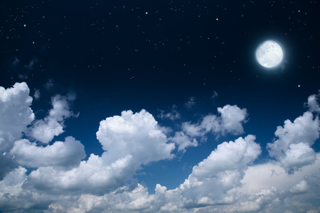 fluffy clouds: beautiful background, nightly sky with full moon Stock Photo