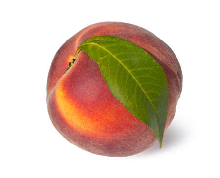 Juicy fresh peach with leaves