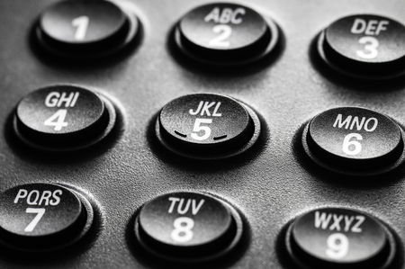 dial pad: Close-up of a black telephone keypad and dial pad buttons.