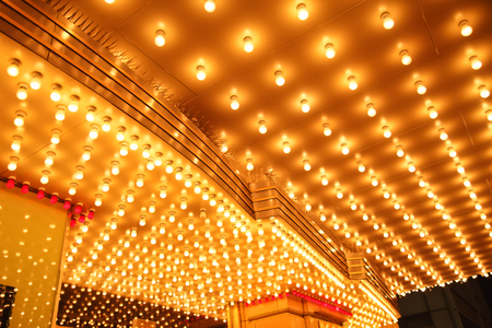 Theatre Marquee Lights - Picture of rows of theater marquee lights on the ceiling of an old theater entrance Redakční