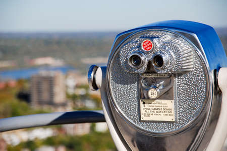 Picture of coin operated tourist pay binoculars on a building roof