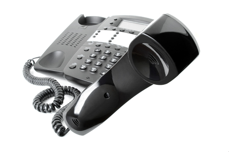 Business phone with receiver hovering in mid-air isolated on a white background