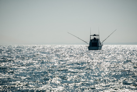 Picture of a charter fishing boat on Lake Michigan in the United States. Stock Photo