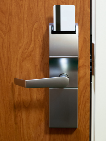 Hotel room electronic door lock with keycard Stock Photo