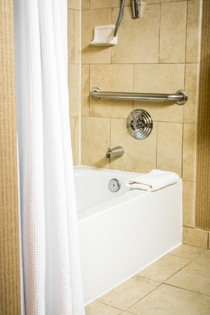 impaired: Handicapped Accessible Bathtub in a Hotel Room with Grab Bar Hand Rails