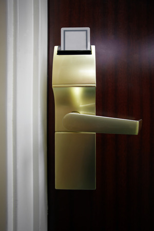 Picture of a hotel room electronic door lock with a keycard