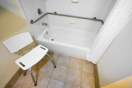 Disabled Access Bathtub And Chair In A Hotel Photo