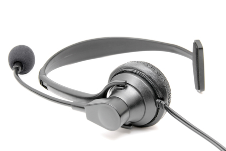 earpiece: Black business telephone headset isolated on a white background. Stock Photo