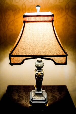 nightstand: Decorative lamp on a nightstand