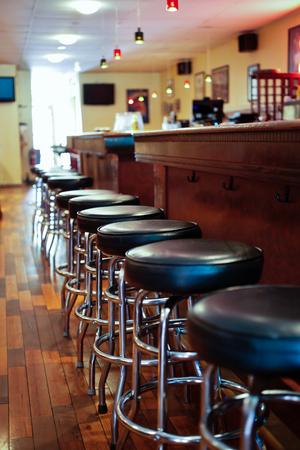 Bar stools at a sports pub tavern