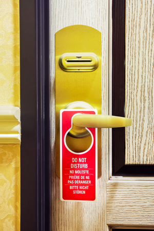 Do Not Disturb sign on a hotel room door Stock Photo