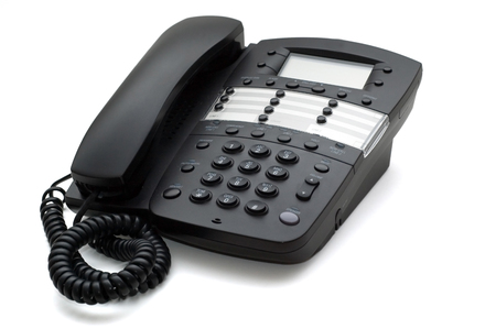 Picture of black business office telephone isolated on a white background. Reklamní fotografie