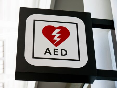 Picture of AED Emergency Defibrillator sign mounted to a wall
