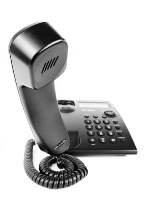 Picture of a business phone receiver hovering in the air isolated on a white background