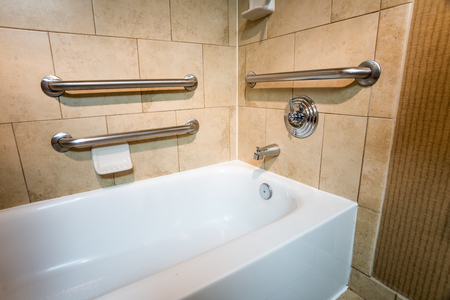 Handicapped Access Bathtub in a Hotel Room with Grab Bar Hand Rails
