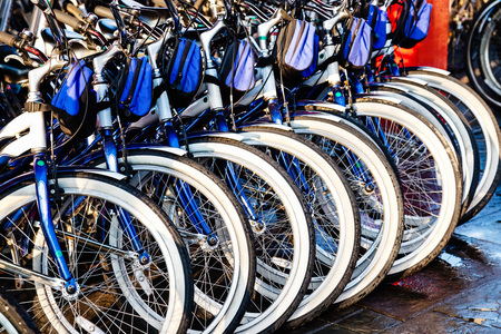 Rental bicycles in a row at a city bike rental business Reklamní fotografie