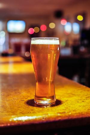 Beer glass on a restaurant bar counter