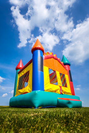 Bounce house inflatable jump castle in yard. Image Copyright � 2009 Paul Velgos with All Rights Reserved. Stock Photo
