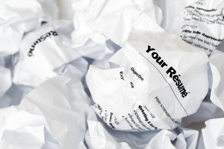 Picture of résumé crumpled up and thown away in the garbage