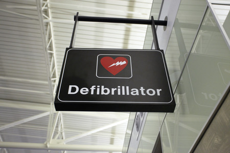 Picture of a defibrillator sign at airport for AED Automated External Defibrillators